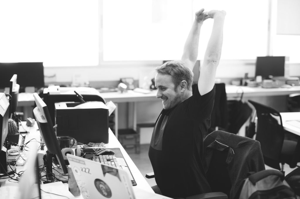 happy guy at computer, how to better avoid downtime and costly computer repair