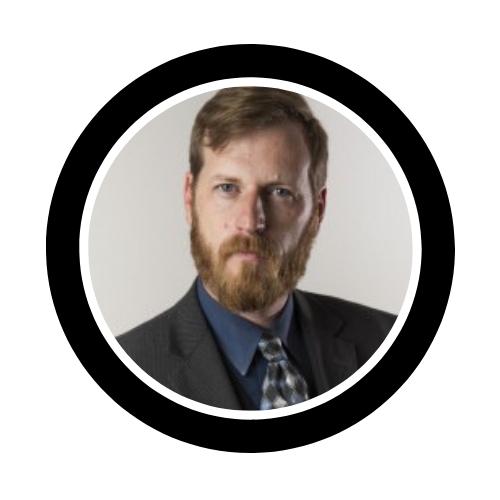 Adam Coker headshot bio